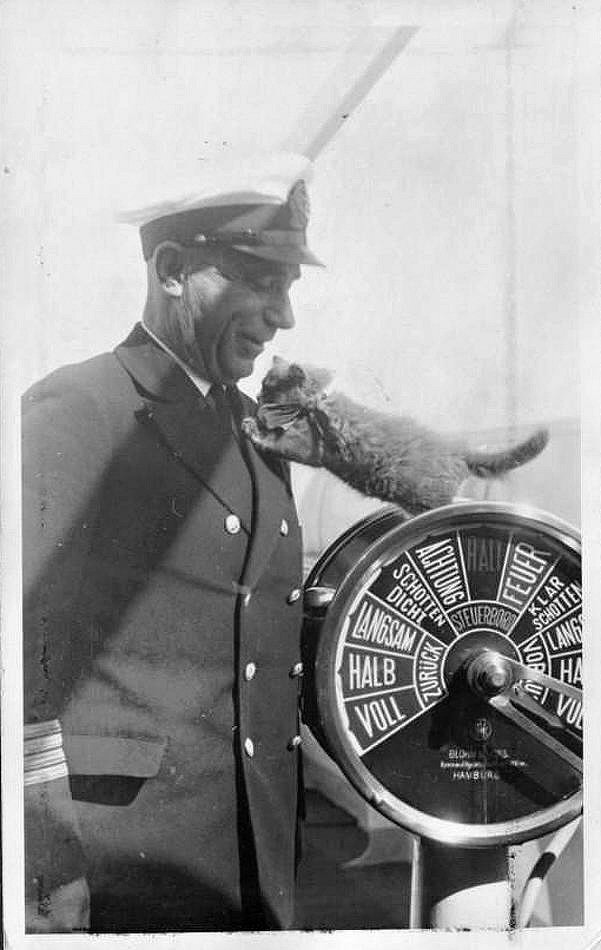Monte Pascoal Captain Paul Hoffner & Ship's Cat.jpg