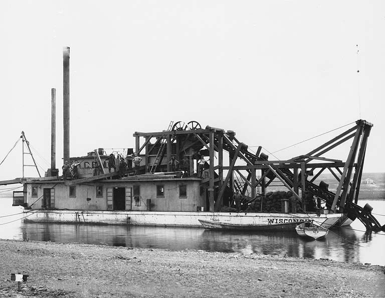 Dredging_on_the_Snake_River_with_the_WISCONSIN,_Nome,_Alaska,_ca_1901_(HEGG_543).jpeg