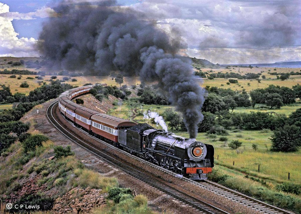 5-289s5,-Bloemfontein-Kroonstad,-Karee,-3231-cl-23-on-209,-the-eastbound-Orange-Express,-February-1973-red-h.jpg